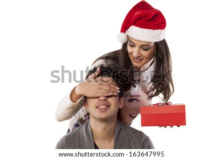 Wife Surprising Her Husband Christmas Gift Stock Photo (Edit