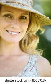 Wife wearing straw hat.