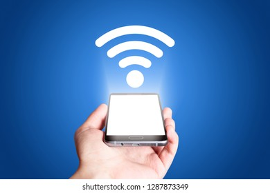 Wifi icon. Mobile phone on blue background