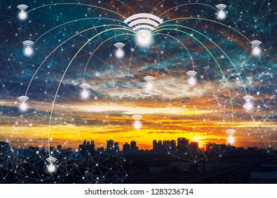 Wifi icons with lines connection symbol in the sky over the modern business city center at sunset with beautiful sky. Wireless network connection technology concept.
