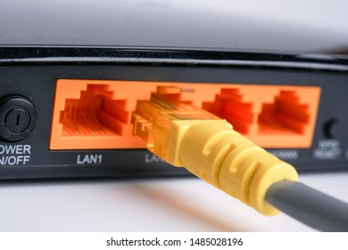 WiFi Modem Router ADSL connected with LAN RJ45 Cable. It is a LAN network connection ethernet cable. Internet cord RJ45