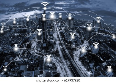 Wifi network connection concept and Network business conection system on blue tone Aerial view of cityscape Bangkok business district at twilight  background.