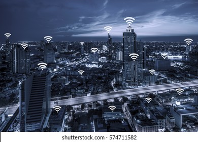 Wifi network connection concept on blue tone Aerial view of cityscape Bangkok business district at twilight  background.