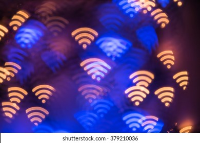 Wifi symbol. Abstract glowing blurred background. Bokeh. Defocused blinking shaped lights. Wi-fi backdrop