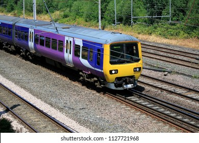 Wigan, Lancashire / England - July 05 2018 Northern Rail Arriva train travelling near Wigan on day RMT union announce more industrial action