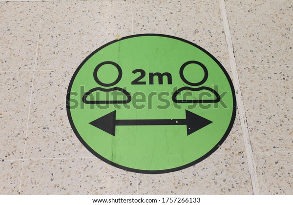Wigan, Manchester, UK, 16/06/2020, A green social distancing sticker on the floor informing shoppers to stay two metres apart during the CoVid pandemic