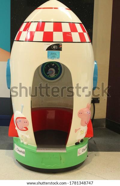 Wigan, Manchester, UK, 22/07/2020: peppa pig spaceship rocket, childrens in store ride