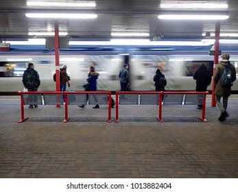 WIGAN, UK, JANUARY 31 2018 - Morning commuters wait for the 08:38 Virgin train to London Euston to come to a halt at Wigan North Western station before they can board.