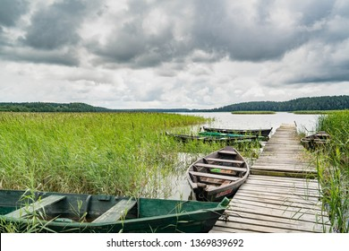 Wigry lake with jetty and rowboats, Wigry National Park, Poland
