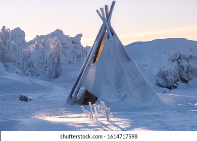 Wigwam in the snow-white forest and a lot of fresh snow