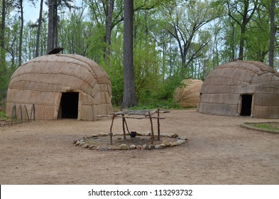 wigwam type thatch huts in native american camp site