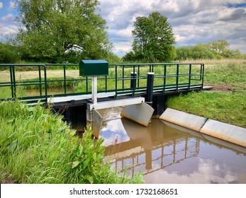 Wijdemeren, Netherlands- May 15 2020: A small water lock in the rural area of Wijdemeren levels the water in a very dry spell. It's essential for the Horstermeerpolder to keep its water balanced.