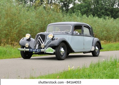 WIJHE, THE NETHERLANDS - SEPTEMBER 4: A Citroën Avant Traction 11B from 1956 drives past at the 10th Diekdaegen classic car tour on September 4, 2011 in Wijhe, The Netherlands