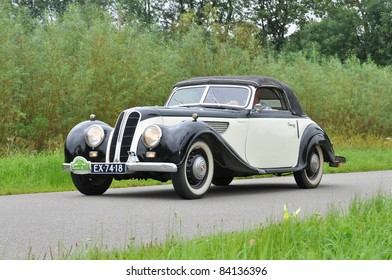 WIJHE, THE NETHERLANDS - SEPTEMBER 4: A BMW/ EMW 327 from 1954 drives past at the 10th Diekdaegen classic car tour on September 4, 2011 in Wijhe, The Netherlands