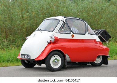 WIJHE, THE NETHERLANDS - SEPTEMBER 4: A BMW Isetta 300 from 1955 drives past at the 10th Diekdaegen classic car tour on September 4, 2011 in Wijhe, The Netherlands