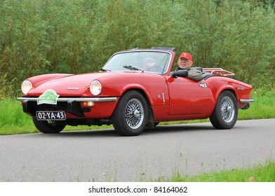 WIJHE, THE NETHERLANDS - SEPTEMBER 4: A Triumph Spitfire Mk4 from 1973 drives past at the 10th Diekdaegen classic car tour on September 4, 2011 in Wijhe, The Netherlands