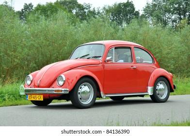 WIJHE, THE NETHERLANDS - SEPTEMBER 4: A Volkswagen Beetle 112111 from 1984 drives past at the 10th Diekdaegen classic car tour on September 4, 2011 in Wijhe, The Netherlands