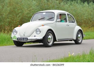 WIJHE, THE NETHERLANDS - SEPTEMBER 4: A Volkswagen Beetle 111011 from 1969 drives past at the 10th Diekdaegen classic car tour on September 4, 2011 in Wijhe, The Netherlands