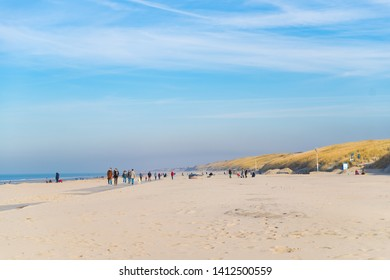 WIJK AAN ZEE, NETHERLANDS - FEBRUARY 17, 2019: Unknown people enjoy the early spring sun on the beach