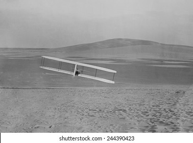 Wilbur Wright 1867-1912 making a right turn in a glider at Kitty Hawk North Carolina. October 24 1902.