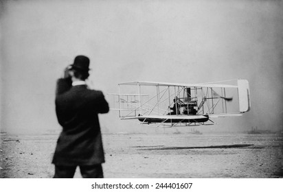Wilbur Wright 1867-1912 takes off for a flight over New York harbor on Sept. 29 1909. Wilber made three flights including a 20 mile round trip from Governors Island to Grant's Tomb.