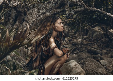 wild amazon woman in forest with eyes closed