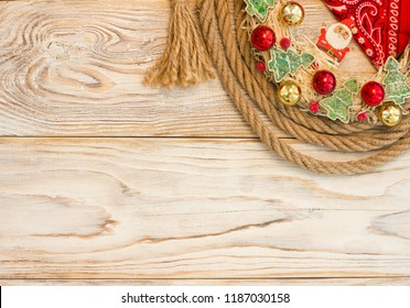 Wild American christmas background with christmas wreath and cowboy lasso on wood texture for text