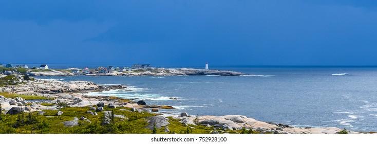 A wild angle view of the Peggy's Cove lighthouse on the coast of Nova Scotia