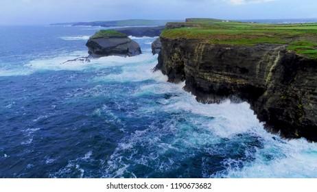 Wild Atlantic Ocean water at the steep cliffs of Ireland