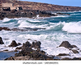 wild atlantic with waves and spray on a funeral spring day with fierce wind in Puertito de Guimar on Tenerife, Canarian Island.