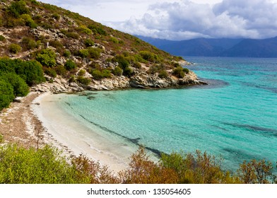 Wild beach along the seaboard way through Desert of Agriates to plage of Saleccia, Corsica, France