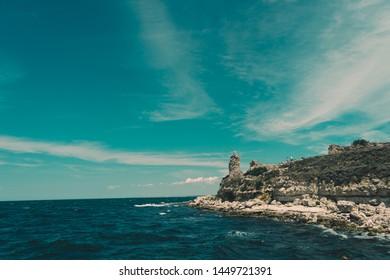 Wild beach by the rock