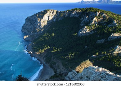 Wild beach Coll Baix on Mallorca in shadow by The Mediterranean Sea - high angle view from above.