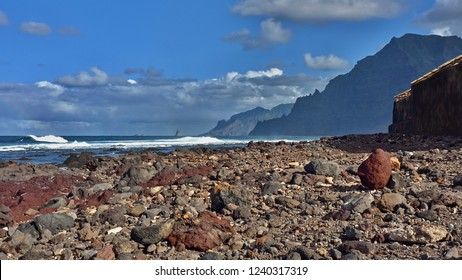 """wild beach at the foot of the """"Anaga Mountain"""" on Tenerife (Canary Island). The beach is made of different stones in many differentiated colors, all volcanic rock. Right  the contours from """"Anaga"""""""