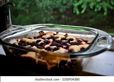 Wild blackberry cobbler cooling on a windowsill