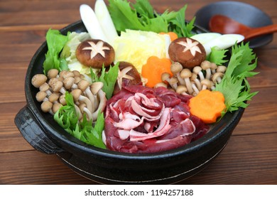 Wild boar meat dish served in a pot