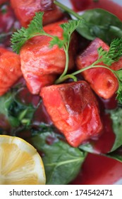 Wild caught salmon in a reduction sauce with greens