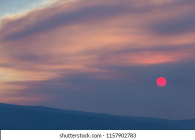 Wild Fire Smoke Sunset with Red Sun