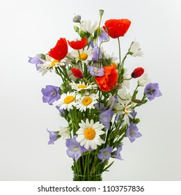 Wild flower posy over white background.