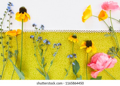 Wild Flowers shot from above on textile background with white border.