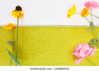 Wild Flowers shot from above on textile background with white space.