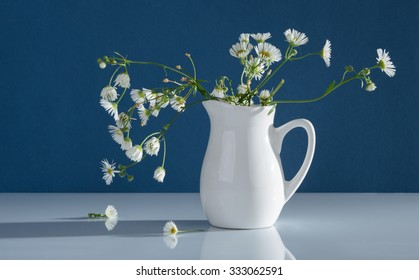 Wild flowers in a vase on a table