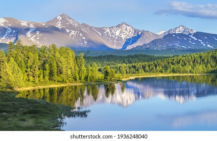Wild forest lake in the Altai mountains on a summer morning, picturesque reflection