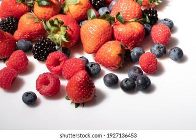 Wild fresh berries overlay on white background