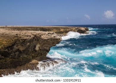Wild and high waves breaking at the rough shoreline of the Caribbean west coast of the Caribbean island of Bonaire