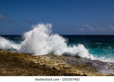 Wild and high waves breaking at the rough shoreline of the Caribbean east coast of the Caribbean island of Bonaire