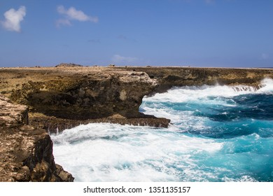 Wild and high waves breaking at the rough shoreline of the east coast of the island of Bonaire in the Caribbean