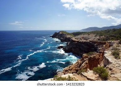 Wild inhospitable, covered only with desert vegetation and juniper bushes of the' Punta del Gost ' Peninsula.Ibiza Island.Spain.