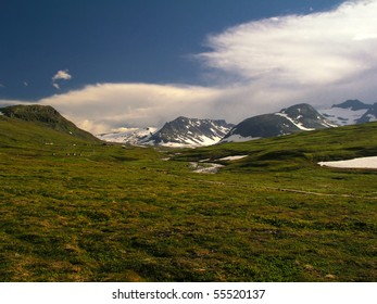 Wild ladscape of snow mountain and meadow