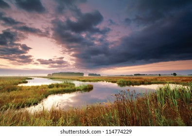 wild lake in Drenthe in summer at sunrise